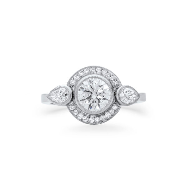 round brilliant cut diamond halo engagement ring with pear cut side stones