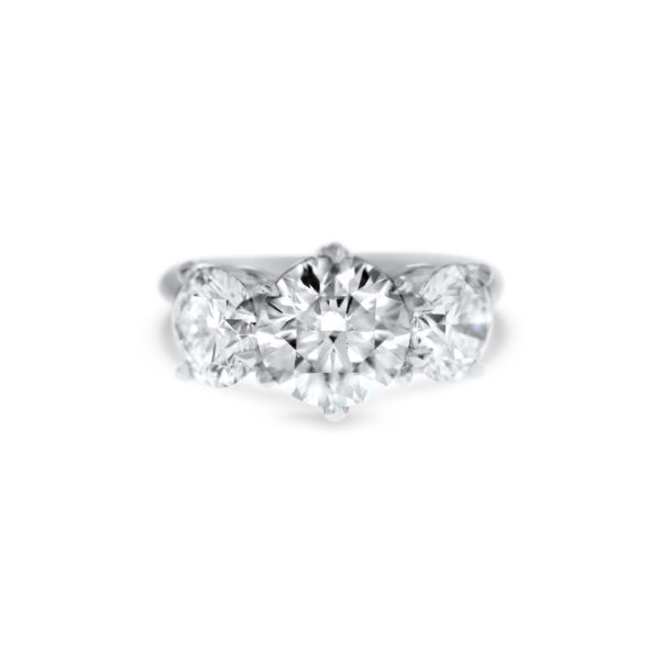 signature round brilliant cut three stone engagement ring