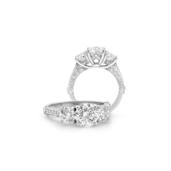 Coronet round brilliant cut three-stone engagement ring