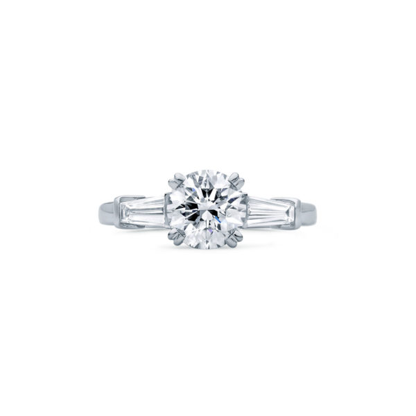 An Art Deco Inspired diamond three stone engagement ring