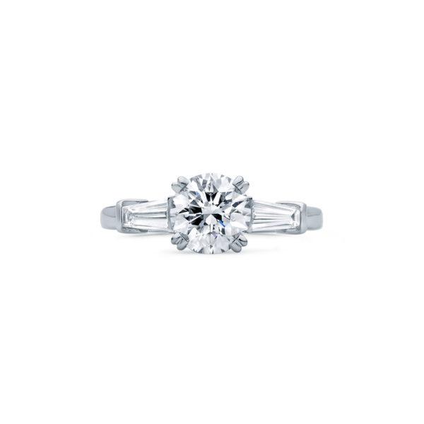An Art Deco Inspired diamond three stone engagement ring