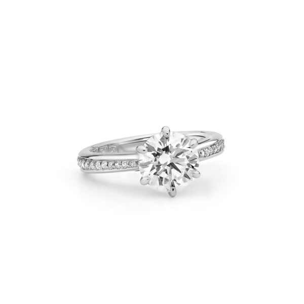 Round brilliant cut engagement ring with diamond accents