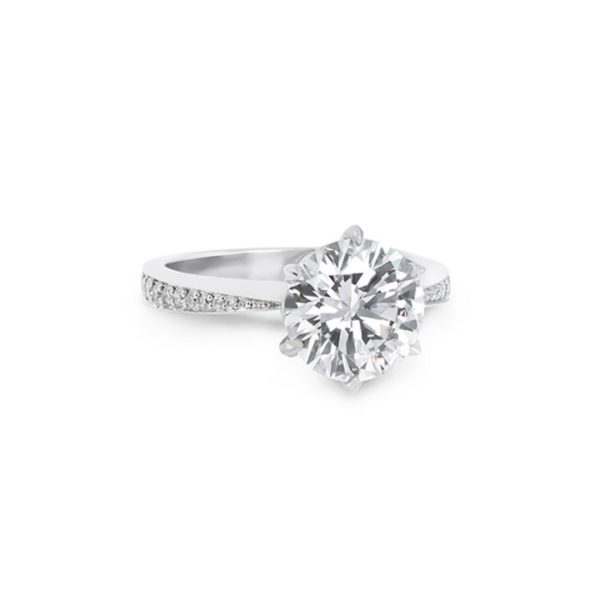 Round brilliant cut engagement ring with a diamond accented band