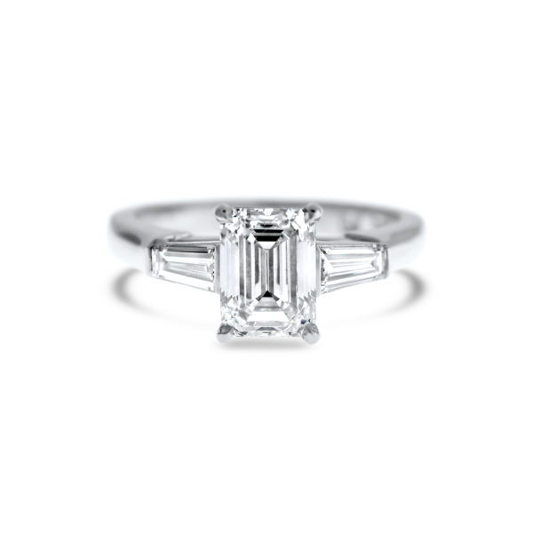 emerald cut diamond three stone engagement ring