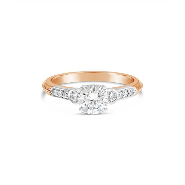 Round Brilliant Diamond and Double Claw Engagement Ring