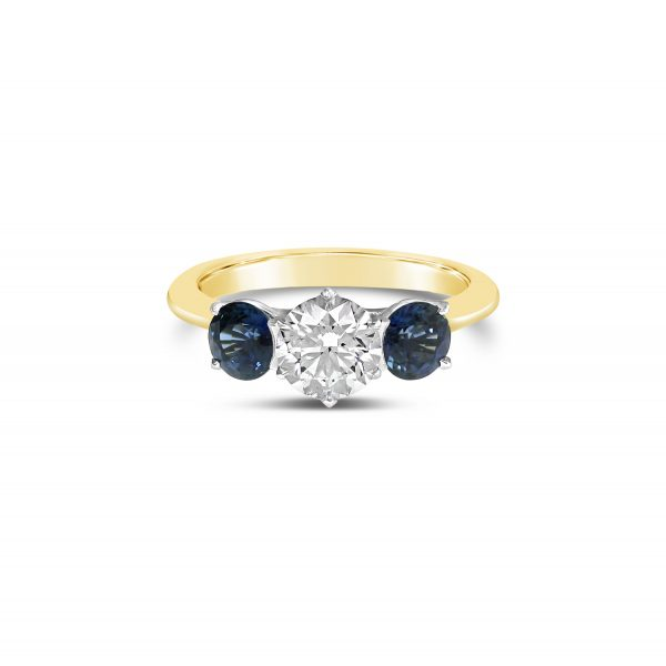 round sapphire three stone engagement ring